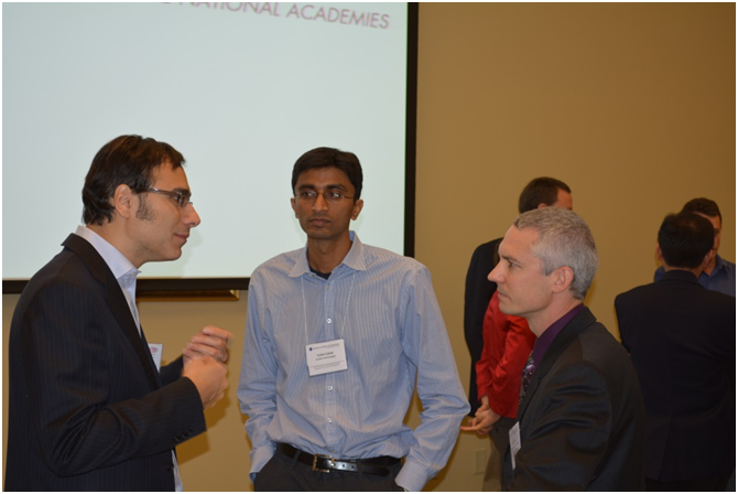 Dr. Tony Jebara of Columbia University (left) discusses his research in modeling large-scale networks with fellow FOE participants during the break.