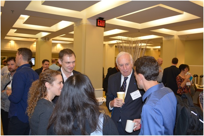 Dr. Daniel Mote, president of the NAE, speaks with FOE participants during the morning break.