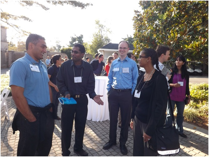 Lively discussions were held during Friday evening's poster session and social events, held at the DuPont Country Club.