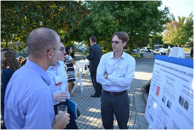 DuPont researchers engaged the visiting NAE FOE engineers with a poster session on the patio of the DuPont Country Club.