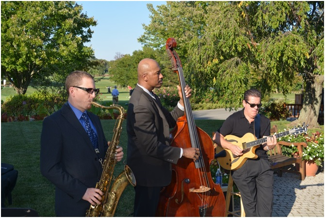 The Tony Forliano Jazz Trio entertained the crowd during Friday evening's U.S. NAE FOE Symposium events, including the poster session, lawn games, and barbeque buffet dinner.